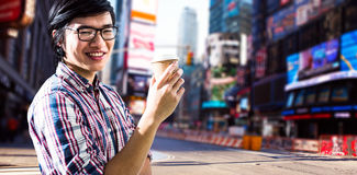 Composite image of smiling creative businessman with take-away coffee Royalty Free Stock Image