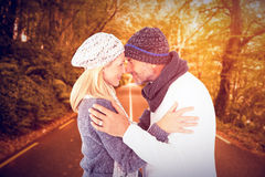 Composite image of smiling cute couple romancing over white background Royalty Free Stock Photos