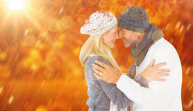Composite image of smiling cute couple romancing over white background Royalty Free Stock Photo