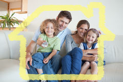 Composite image of smiling family watching tv together. Smiling family watching TV together against house outline Stock Photography