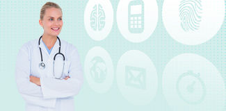 Composite image of smiling female doctor standing arms crossed Stock Image