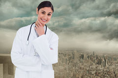 Composite image of smiling female doctor in thinkers pose Stock Photography