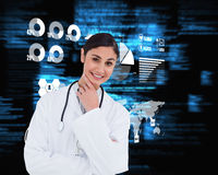 Composite image of smiling female doctor in thinkers pose Stock Image