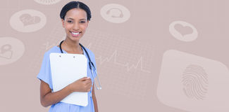 Composite image of smiling female surgeon holding clipboard Stock Photos