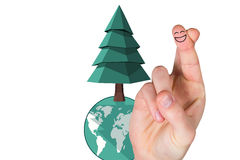 Composite image of smiling fingers. Smiling fingers against earth day graphic Stock Photo
