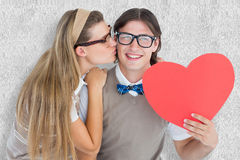 A Composite image of smiling geeky hipster and his girlfriend Stock Photos