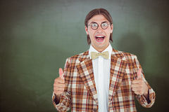 Composite image of smiling geeky hipster smiling at camera Royalty Free Stock Photo