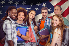 Composite image of smiling group of students holding folders Stock Photo