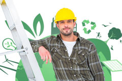 Composite image of smiling handyman in overalls leaning on ladder. Smiling handyman in overalls leaning on ladder  against fair trade graphic Stock Photography