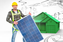 Composite image of smiling handyman with solar panel Royalty Free Stock Photo