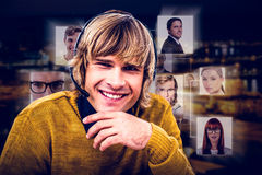 Composite image of smiling hipster businessman using headset. Smiling hipster businessman using headset against illuminated buildings in city Royalty Free Stock Photography