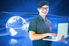 Composite image of smiling hipster businessman using tablet Royalty Free Stock Images