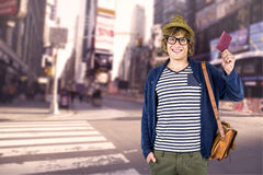 Composite image of smiling hipster holding a leather wallet Stock Image