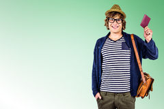 Composite image of smiling hipster holding a leather wallet Royalty Free Stock Image