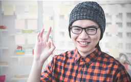 Composite image of smiling hipster making ok sign Royalty Free Stock Image