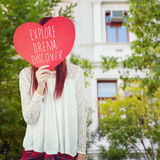 Composite image of smiling hipster woman behind a big red heart Royalty Free Stock Photos