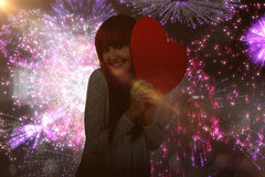 Composite image of smiling hipster woman with a big red heart Stock Photography