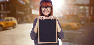Composite image of smiling hipster woman holding blackboard Stock Images