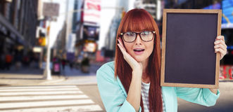 Composite image of smiling hipster woman holding blackboard Royalty Free Stock Photos