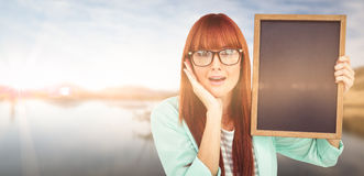 Composite image of smiling hipster woman holding blackboard Royalty Free Stock Images