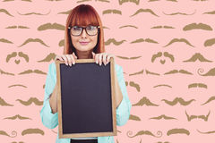 Composite image of smiling hipster woman holding blackboard Stock Photos