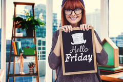 Composite image of smiling hipster woman holding blackboard Stock Image