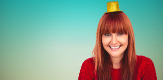Composite image of smiling hipster woman with party hat Royalty Free Stock Images