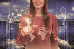 Composite image of smiling hipster woman pointing something. Smiling hipster woman pointing something against server room in blue stock image