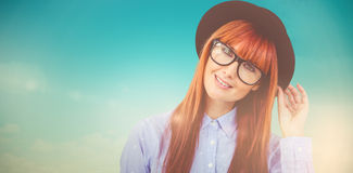 Composite image of smiling hipster woman posing face to the camera Royalty Free Stock Photography