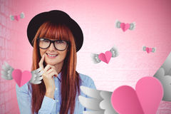 Composite image of smiling hipster woman posing face to the camera Royalty Free Stock Photos