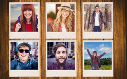 Composite image of smiling hipster woman with a travel bag taking selfie Royalty Free Stock Photography