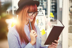 Composite image of smiling hipster woman writing notes Royalty Free Stock Photography