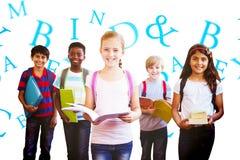 Composite image of smiling little school kids in school corridor Stock Photos