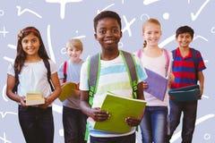 Composite image of smiling little school kids in school corridor Royalty Free Stock Photos