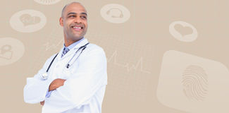 Composite image of smiling male doctor standing arms crossed Stock Photos