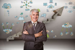 Composite image of smiling male manager with arms crossed Stock Photography
