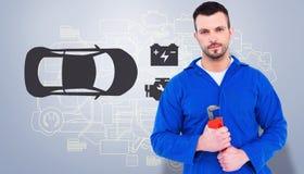 Composite image of smiling male mechanic holding monkey wrench Stock Photo