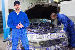 Composite image of smiling male mechanic holding spanner Stock Photo
