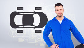 Composite image of smiling male mechanic holding tire Stock Photography