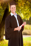 Composite image of a smiling man looking at the camera as he graduates Royalty Free Stock Photos