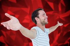 Composite image of smiling man standing arms outstretched. Smiling man standing arms outstretched against red abstract design Royalty Free Stock Photography