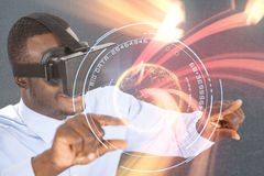 Composite image of smiling man using virtual reality headset while pointing Royalty Free Stock Photo