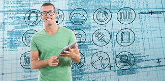Composite image of smiling man wearing glasses while holding digital tablet Stock Image