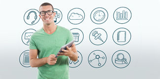 Composite image of smiling man wearing glasses while holding digital tablet Stock Images