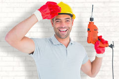 Composite image of smiling manual worker holding drill machine Royalty Free Stock Photography