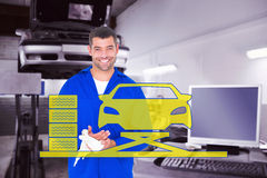 Composite image of smiling mechanic wiping hands with cloth Royalty Free Stock Photography