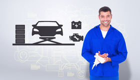 Composite image of smiling mechanic wiping hands with cloth Royalty Free Stock Images