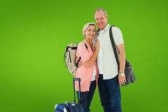 Composite image of smiling older couple going on their holidays Royalty Free Stock Photo