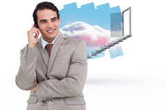 Composite image of smiling salesman on his cellphone Stock Images