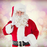 Composite image of smiling santa claus with his sack Stock Image